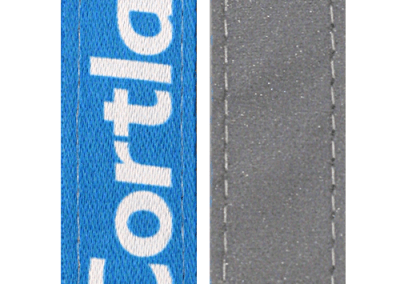 Polyester + bande réfléchissante verso